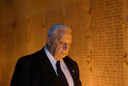 Israeli Prime Minister Ariel Sharon attends a memorial ceremony at the ''Wall of Names'' October 3, 2002 at the Israeli army's Armored Corps' Memorial at Latrun, Israel. REUTERS/David Silverman/POOL/Files