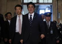 Japan's Prime Minister Shinzo Abe walks to an ordinary session at the lower house of parliament in Tokyo January 28, 2013. REUTERS/Toru Hanai