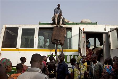 Malian who fled unrest in the rebel-held northeastern cities of Gao and Timbuktu arrive by bus in the capital Bamako April 11, 2012. REUTERS/Joe Penney/Files