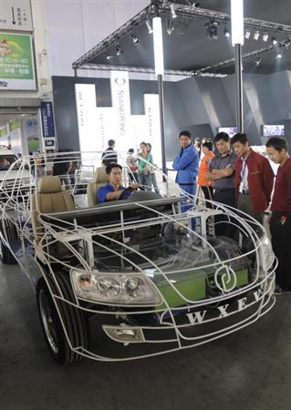 People look at an electric car model made by Wanxiang Group Corp. during an exhibition in Hangzhou, Zhejiang province, October 15, 2008. REUTERS/Stringer/Files