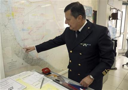 Admiral Francesco Saverio Ferrara of Italy points at a map which shows the coordinates to search for a U.S. F-16 fighter jet that went missing over the Adriatic sea, in Ravenna January 29, 2013. REUTERS/Giorgio Benvenuti