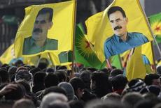 Demonstrators hold flags with portraits of jailed Kurdistan Workers Party (PKK) leader Abdullah Ocalan during a protest in Strasbourg February 18, 2012. REUTERS/Vincent Kessler
