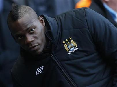 Manchester City's Mario Balotelli takes his seat on the bench before their FA Cup soccer match against Watford at The Etihad Stadium in Manchester, northern England January 5, 2013. REUTERS/Phil Noble