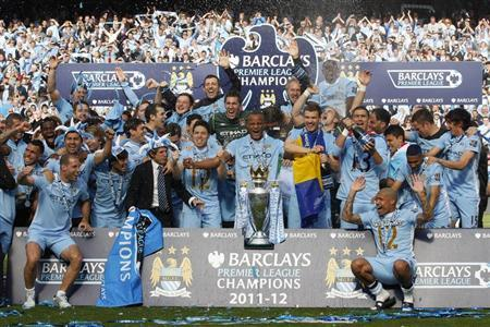 The Manchester City team celebrate winning the English Premier League following their soccer match against Queens Park Rangers at the Etihad Stadium in Manchester, northern England, May 13, 2012. REUTERS/Darren Staples