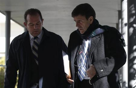 Spanish doctor Eufemiano Fuentes (R) leaves a courthouse on the first day of the high-profile Operacion Puerto doping trial in Madrid, January 28, 2013. REUTERS/Sergio Perez
