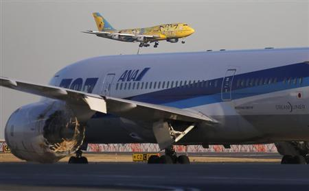 All Nippon Airways' (ANA) Pokemon Jet (top) approaches to land above ANA's Boeing Co's 787 Dreamliner plane at Haneda airport in Tokyo January 29, 2013. REUTERS/Toru Hanai