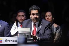 Venezuela's Vice President Nicolas Maduro reads a letter from Venezuela's President Hugo Chavez during a general meeting at the summit of the Community of Latin American and Caribbean States (CELAC) in Santiago in this picture provided by the Summit Press on January 28, 2013. REUTERS/Summit Press/Handout