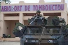French troops, aboard an armoured vehicle, guard the Timbuktu airport in this January 28, 2013 picture provided by the French Military audiovisual service (ECPAD) January 29, 2013. REUTERS/Arnaud Roine/ECPAD/Handout