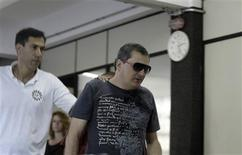 Mauro Hoffman (R), who is one of the owners of the Boate Kiss nightclub, is pictured after turning himself in at the police station in the southern city of Santa Maria, 187 miles (301 km) west of the state capital Porto Alegre, January 28, 2013. REUTERS/Stringer (BRAZIL - Tags: DISASTER CRIME LAW TPX IMAGES OF THE DAY)