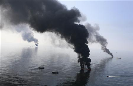 Smoke billows from a controlled burn of spilled oil off the Louisiana coast in the Gulf of Mexico coast line in this file photo taken June 13, 2010. REUTERS/Sean Gardner/Files