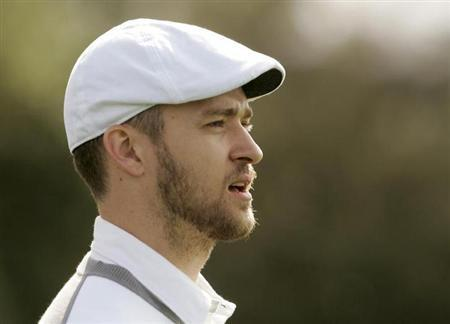 Entertainer Justin Timberlake walks the third fairway during the celebrity challenge of the Pebble Beach National Pro-Am in Pebble Beach, California February 11, 2009. REUTERS/Robert Galbraith