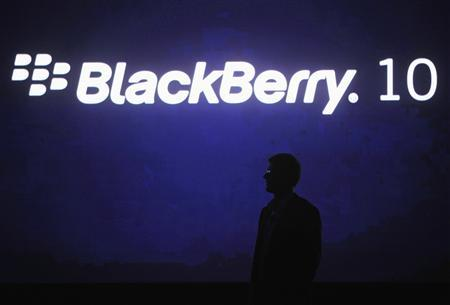 Research in Motion Chief Executive Officer Thorsten Heins is silhouetted during the BlackBerry World event in Orlando May 1, 2012. REUTERS/David Manning