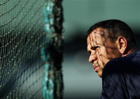 New York Yankees' Alex Rodriguez awaits his turn in the batting cage prior to their MLB American League baseball game against the Oakland Athletics in Oakland, California July 7, 2010. REUTERS/Robert Galbraith