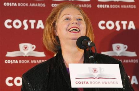 Author Hilary Mantel reacts as she makes a joke while accepting her award for the overall prize for her book ''Bring up the Bodies'' at the Costa Book Awards in central London, January 29, 2013. REUTERS/Andrew Winning
