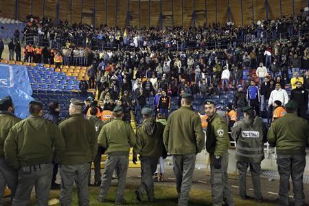Israeli border policemen stand in position as they guard supporters of Maccabi Umm el-Fahm during a soccer match against Beitar Jerusalem at Teddy Stadium in Jerusalem January 29, 2013. REUTERS/Nir Elias