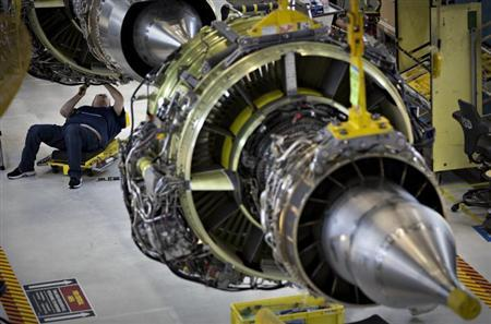 A worker builds an engine for the Boeing 737-900 at their assembly operations in Renton, Washington, October 18, 2012. REUTERS/Andy Clark/Files