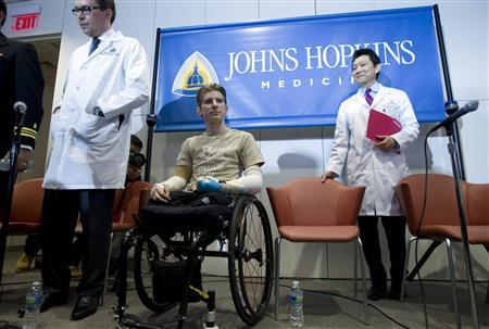 U.S. soldier who lost four limbs leaves hospital with transplant arms