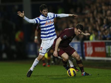 Manchester City's James Milner (R) is challenged by Queen's Park Rangers' Estaban Granero during their English Premier League soccer match at Loftus Road Stadium in London January 29, 2013. REUTERS/Stefan Wermuth