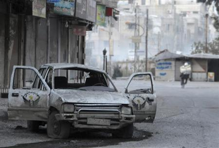 A damaged car, used by Free Syrian Army fighters, is seen on a street in Mleha suburb of Damascus, January 24, 2013. REUTERS/Sami Zbeidi