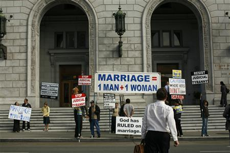 Supporters of California's Proposition 8 ban on gay marriage protest outside the California Supreme Court in San Francisco, California before a hearing on the initiative September 6, 2011. REUTERS/Robert Galbraith