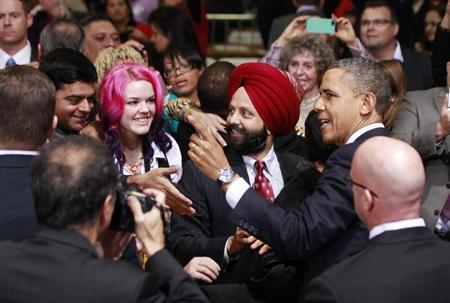 U.S. President Barack Obama greets members of the audience after delivering remarks on immigration reform at Del Sol High School in Las Vegas, January 29, 2013. REUTERS/Jason Reed