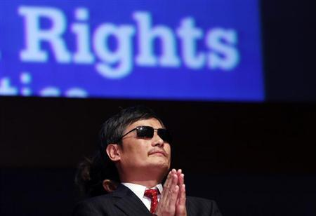 Chinese dissident Chen Guangcheng listens to remarks during a ceremony awarding him The Tom Lantos Human Rights Prize in the Capitol in Washington January 29, 2013. Behind Chen is a translator. REUTERS/Kevin Lamarque