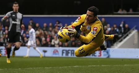 Queens Park Rangers' goalkeeper Julio Cesar saves a shot from Tottenham Hotspur's Sandro (unseen) during their English Premier League soccer match at Loftus Road in London January 12, 2013. REUTERS/Eddie Keogh