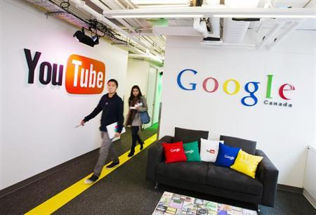 People walk by a YouTube sign at the new Google office in Toronto, November 13, 2012. REUTERS/Mark Blinch/Files
