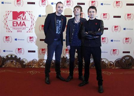 British band Muse arrive on the red carpet for the MTV European Music Awards 2012 at the Festhalle in Frankfurt November 11, 2012. REUTERS/Lisi Niesner