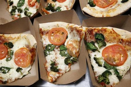 Pizza is shown for sale in the cafeteria at a middle school in San Diego, California March 7, 2011. REUTERS/ Mike Blake/Files