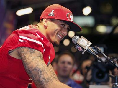 49ers' Kaepernick rises, without fear, to the ultimate...
