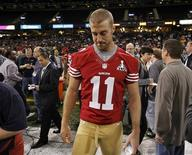 San Francisco 49ers quarterback Alex Smith walks on the field after he was not given a booth to answers question from journalists during Media Day for the NFL's Super Bowl XLVII in New Orleans, Louisiana January 29, 2013. The 49ers will meet the Baltimore Ravens in the game on February 3. REUTERS/Joe Skipper