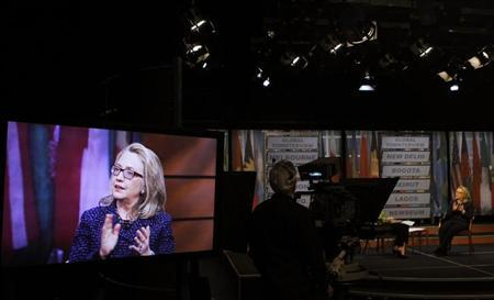 U.S. Secretary of State Hillary Clinton's image is seen on a studio monitor (L) while questioned by Australian journalist Leigh Sales (obscured) during a Global Town Townterview at the Newseum in Washington January 29, 2013. REUTERS/Gary Cameron