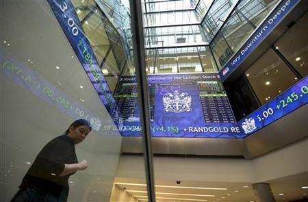 Electronic information boards display market information at the London Stock Exchange in the City of London January 2, 2013. REUTERS-Paul Hackett