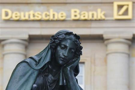 A statue is pictured in front of the former head quarters of Germany's largest business bank, Deutsche Bank in Frankfurt, January 28. Deutsche Bank will announce its annual figures on Thursday, January 31. REUTERS/Kai Pfaffenbach (GERMANY - Tags: BUSINESS