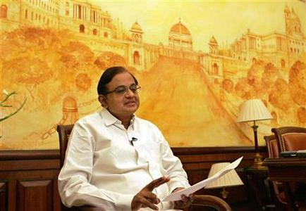 Finance Minister Palaniappan Chidambaram gestures during an interview in New Delhi September 15, 2005. REUTERS/Kamal Kishore/Files