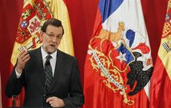 Spain's Prime Minister Mariano Rajoy speaks to the media after a bilateral meeting with Chile's President Sebastian Pinera at La Moneda Presidential Palace during the summit of the Community of Latin American, Caribbean States and European Union (CELAC-UE) in Santiago January 25, 2013. Rajoy is in Chile on an official visit and to attend the CELAC-UE. REUTERS/Eliseo Fernandez (CHILE - Tags: POLITICS)