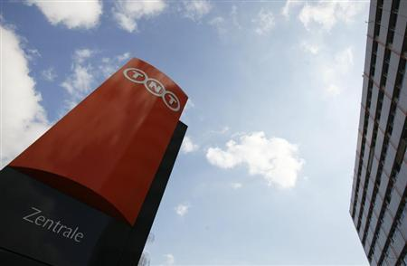 Clouds are seen over the logo of Dutch peer TNT at the company's headquarters in Troisdorf near Bonn March 19, 2012. REUTERS/Wolfgang Rattay