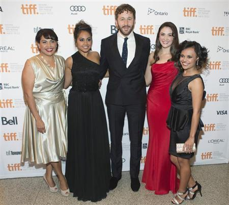 Actors (L-R) Deborah Mailman, Jessica Mauboy, Chris O'Dowd, Shari Sebbens, and Miranda Tapsell, arrives on the red carpet for the gala presentation of the film ''The Sapphires'' at the 37th Toronto International Film Festival, September 9, 2012. REUTERS/Mark Blinch