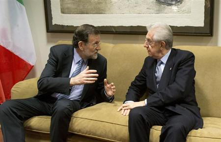 Spain's Prime Minister Mariano Rajoy (L) speaks with Italian Prime Minister Mario Monti during a meeting on the sidelines of an EU summit in Brussels December 13, 2012