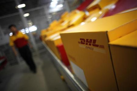 An employee is seen next to his workstation during a operational test of the new DHL North Asia Hub in Shanghai July 12, 2012. REUTERS/Carlos Barria