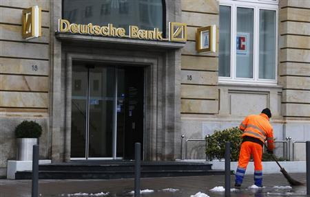 A road sweeper cleans the street in front of a branch of Germany's largest business bank, Deutsche Bank in Frankfurt, January 28. Deutsche Bank will announce its annual figures on Thursday, January 31. REUTERS/Kai Pfaffenbach (GERMANY - Tags: BUSINESS)