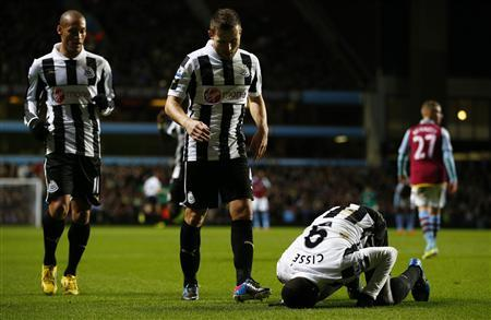 Newcastle United's Papiss Cisse (R) celebrates his goal against Aston Villa during their English Premier League soccer match at Villa Park in Birmingham, central England, January 29, 2013. REUTERS/Darren Staples