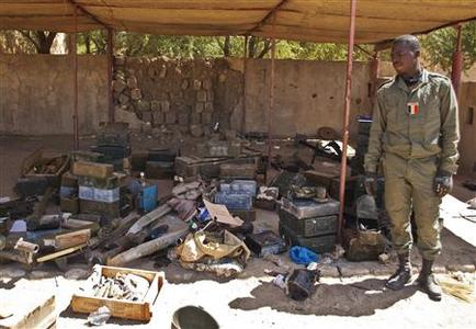 A Malian soldier displays ammunition seized from Islamists rebels after their departure, in Timbuktu January 29, 2013. REUTERS/Francois Rihouay