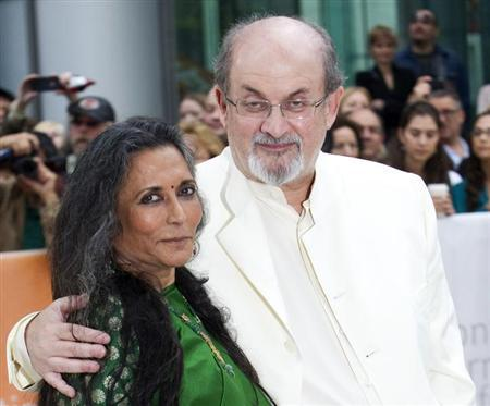Director Deepa Mehta (L) and author Salman Rushdie arrive at the gala presentation for the film ''Midnight's Children'' during the 37th Toronto International Film Festival, September 9, 2012. REUTERS/Fred Thornhill