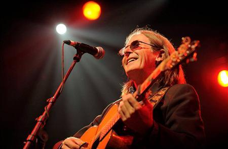 Musician Dougie MacLean is seen performing in this undated photograph in provided by Butterstone Studios and received in London on January 28, 2013. In the 1970s, before he could make a living playing music, Scottish folk singer MacLean found himself with a temporary job driving an American family around Europe in a mini-bus. REUTERS/RobMcDougall.com/Butterstone Studios/Handout