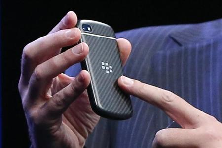 Research in Motion (RIM) President and Chief Executive Officer Thorsten Heins points to a new RIM Blackberry 10 device during its launch in New York January 30, 2013. REUTERS/Shannon Stapleton