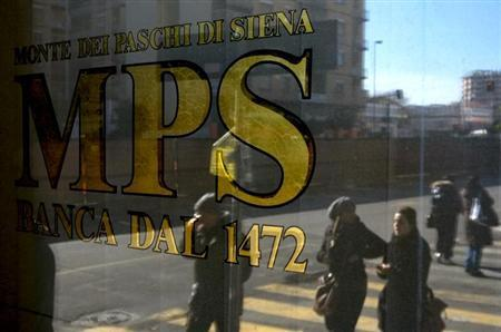 People are reflected in the window of a Monte Dei Paschi Di Siena bank in Rome January 29, 2013. out. REUTERS/Max Rossi