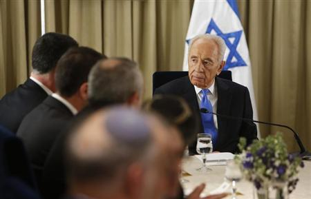 Israel's President Shimon Peres (R) sits next to representatives of Israeli Prime Minister Benjamin Netanyahu's Likud-Beitenu party in Jerusalem January 30, 2013, after receiving the official results of the general elections held on January 22. REUTERS/Ronen Zvulun