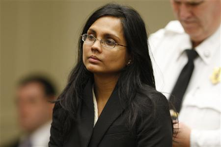 Annie Dookhan, a former chemist at the Hinton State Laboratory Institute, listens to the judge during her arraignment at Brockton Superior Court in Brockton, Massachusetts January 30, 2013. REUTERS/Jessica Rinaldi